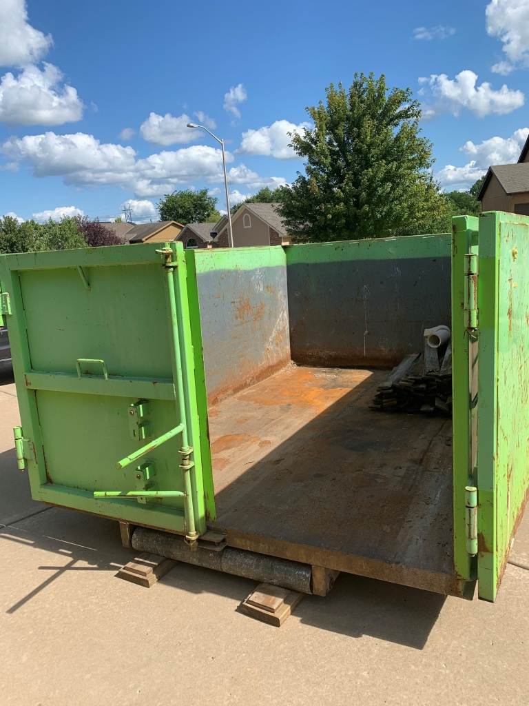 Green dumpster from Bin There Dump That